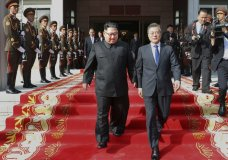 "In this May 26, 2018 photo provided on May 27, 2018, by South Korea Presidential Blue House, North Korean leader Kim Jong Un, center left, and South Korean President Moon Jae-in, right, walk after their meeting at the northern side of Panmunjom in North Korea. Moon said Sunday, May 27, that Kim committed in the rivals' surprise meeting to sitting down with President Donald Trump and to a ""complete denuclearization of the Korean Peninsula."" The Korean leaders' second summit in a month Saturday, May 26, saw bear hugs and broad smiles, but their quickly arranged meeting appears to highlight a sense of urgency on both sides of the world's most heavily armed border. (South Korea Presidential Blue House via AP)"