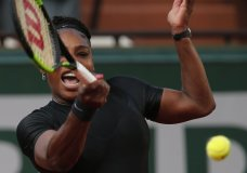 Serena Williams of the U.S. returns a shot against Australia's Ashleigh Barty during their second round match of the French Open tennis tournament at the Roland Garros stadium in Paris, France, Thursday, May 31, 2018. (AP Photo/Thibault Camus)