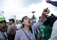 A protester yells toward a Trump supporter after arriving to the Homestead Temporary Shelter for Unaccompanied Children, on Saturday, June 23, 2018, in Homestead, Fla. (AP Photo/Brynn Anderson)