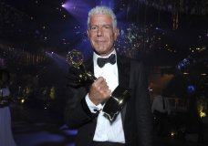 "FILE - In this Sept. 11, 2016 file photo, Anthony Bourdain winner of the award for outstanding informational series or special for ""Anthony Bourdain: Parts Unknown"" attends the Governors Ball during night two of the Creative Arts Emmy Awards at the Microsoft Theater in Los Angeles. Bourdain has been found dead in his hotel room in France, Friday, June 8, 2018, while working on his CNN series on culinary traditions around the world. (Photo by Richard Shotwell/Invision/AP, File)"