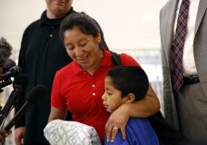 Beata Mariana de Jesus Mejia-Mejia, left, embraces her son Darwin Micheal Mejia as she speaks at a news conference following their reunion at Baltimore-Washington International Thurgood Marshall Airport, Friday, June 22, 2018, in Linthicum, Md. The Justice Department agreed to release Mejia-Mejia's son after she sued the U.S. government in order to be reunited following their separation at the U.S. border. She has filed for political asylum in the U.S. following a trek from Guatemala. (AP Photo/Patrick Semansky)