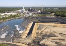 FILE - In this Tuesday, May 1, 2018 file photo, the Richmond city skyline is seen on the horizon behind the coal ash ponds near Dominion Energy's Chesterfield Power Station in Chester, Va. On June 7, 2018, scientists reported the amount of heat-trapping carbon dioxide in the air peaked again this year at record levels. Carbon dioxide is a major greenhouse gas and comes from the burning of coal, gas and oil. (AP Photo/Steve Helber)
