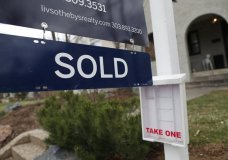 In this Wednesday, March 28, 2018, photograph, a sold sign is shown outside a single-family home on the market in Denver. On Wednesday, June 20, the National Association of Realtors reports on sales of existing homes in May. (AP Photo/David Zalubowski, File)