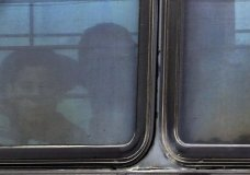 A boy stares out of a heavily tinted bus window leaving a U.S. Customs and Border Protection facility, Tuesday, June 19, 2018, in McAllen, Texas. More than 2,300 minors have been separated from their families crossing the border to the U.S. under a zero-tolerance policy where everyone caught crossing illegally is prosecuted. (AP Photo/Eric Gay)