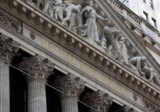 FILE- This April 5, 2018, file photo shows the facade of the New York Stock Exchange. The U.S. stock market opens at 9:30 a.m. EDT on Tuesday, June 26. (AP Photo/Richard Drew, File)