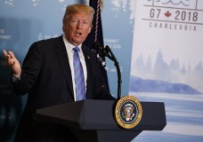 FILE - In this June 9, 2018 file photo, President Donald Trump speaks during a news conference at the G-7 summit in La Malbaie, Quebec, Canada. New York Attorney General sues the Trump Foundation, Thursday, June 14, saying it engaged in a pattern of illegal self-dealing. (AP Photo/Evan Vucci, File)