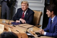 President Donald Trump sits with Canadian Prime Minister Justin Trudeau during a G-7 summit working session, Friday, June 8, 2018, in Charlevoix, Canada. (AP Photo/Evan Vucci)