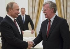 Russian President Vladimir Putin, left, shakes hands with U.S. National security adviser John Bolton during their meeting in the Kremlin in Moscow, Russia, Wednesday, June 27, 2018. U.S. President Donald Trump's national security adviser is due in Moscow Wednesday to lay the groundwork for a possible U.S.-Russia summit. (AP Photo/Alexander Zemlianichenko, Pool)