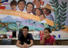 Melvin and Iris, both from Honduras, tell of their separation from their children at the border during a news conference at the Annunciation House, Monday, June 25, 2018, in El Paso, Texas. 32 parents waiting to be reconciled with their children have been released by Border Patrol the the Annunciation House. (AP Photo/Matt York)