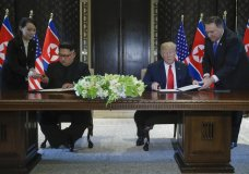 North Korea leader Kim Jong Un and U.S. President Donald Trump prepare to sign a document at the Capella resort on Sentosa Island Tuesday, June 12, 2018 in Singapore. (AP Photo/Evan Vucci)