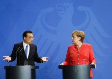 German Chancellor Angela Merkel, right, and Chinese Premier Li Keqiang, left, brief the media during a meeting in the chancellery in Berlin, Monday, July 9, 2018. (AP Photo/Miriam Karout)