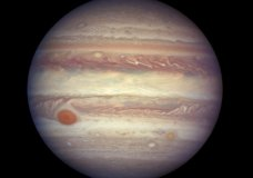 FILE - This April 3, 2017 image made available by NASA shows the planet Jupiter. A team of astronomers is reporting the recent discovery of a dozen new moons circling the giant gas planet. That brings the number of moons at Jupiter to 79, the most of any planet. The astronomers were looking for objects on the fringes of the solar system when they spotted the Jupiter moons. They found a dozen small moons. The confirmation of 10 was announced Tuesday, July 17, 2018; two were confirmed earlier. They're calling one moon an 'oddball' because of its unusual orbit. (NASA, ESA, and A. Simon (GSFC) via AP, File)