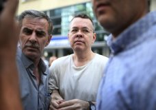 """In this July 25, 2018 photo, Andrew Craig Brunson, an evangelical pastor from Black Mountain, North Carolina, arrives at his house in Izmir, Turkey. An American pastor who had been jailed in Turkey for more than one and a half years on terror and espionage charges was released Wednesday and will be put under house arrest as his trial continues. Vice President Mike Pence said Thursday that if Turkey does not take immediate action to free Brunson, """"the United States of America will impose severe economic sanctions on Turkey,"""" in comments at the close of a three-day conference on religious freedom. (AP Photo/Emre Tazegul)"""