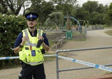 A British police community support officer guards a cordon outside the Queen Elizabeth Gardens park in Salisbury, England, Thursday, July 5, 2018. British officials are seeking clues Thursday in the rush to understand how two Britons were exposed to the military-grade nerve agent Novichok. (AP Photo/Matt Dunham)