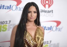 FILE - In this Dec. 1, 2017 file photo, Demi Lovato arrives at Jingle Ball at The Forum in Inglewood, Calif. Emergency officials confirm Tuesday, July 24, 2018, they transported a 25-year-old woman who lives on Demi Lovato's block to the hospital amid reports that the pop star suffered a drug overdose. (Photo by Richard Shotwell/Invision/AP, File)