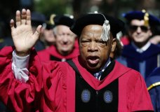 "FILE - In this May 24, 2018 file photo, U.S. Rep. John Lewis walks in a procession during Harvard University commencement exercises in Cambridge, Mass. The Civil rights icon has been hospitalized for undisclosed reasons. Citing a statement from Lewis' office, WSB-TV reports that the 78-year-old Georgia congressman was ""resting comfortably"" in a hospital Saturday night, July 28 for ""routine observation."" The statement says Lewis expects to be released Sunday. (AP Photo/Michael Dwyer, File)"