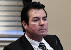 FILE - In this Wednesday, Oct. 18, 2017, file photo, Papa John's founder and CEO John Schnatter attends a meeting in Louisville, Ky. Schnatter is apologizing after reportedly using a racial slur during a conference call in May 2018. The apology Wednesday, July 11, 2018, comes after Forbes cited an anonymous source saying the pizza chain's marketing firm broke ties with the company afterward. (AP Photo/Timothy D. Easley, File)