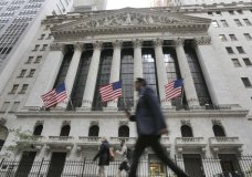 FILE - In this June 24, 2016, file photo, people walk by the New York Stock Exchange. The U.S. stock market opens at 9:30 a.m. EDT on Wednesday, Aug. 29. 2018. (AP Photo/Richard Drew, File)