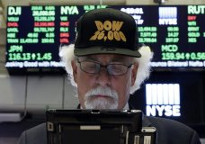 """FILE- In this Aug. 27, 2018, file photo trader Peter Tuchman wears a """"Dow 26,000"""" hat as he works on the floor of the New York Stock Exchange. Stocks are at record highs going into September as Wall Street grows more optimistic about trade tensions easing, but investors should watch out because September is historically the worst month of the year for stocks. (AP Photo/Richard Drew, File)"""