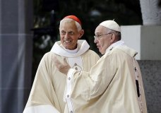 FILE – In this Sept. 23, 2015, file photo, Cardinal Donald Wuerl, archbishop of Washington, left, looks toward the crowd with Pope Francis following a Mass outside the Basilica of the National Shrine of the Immaculate Conception in Washington. Wuerl wrote to priests to defend himself on the eve of the scheduled Tuesday, Aug. 14, 2018, release of a grand jury report investigating child sexual abuse in six of Pennsylvania's Roman Catholic dioceses. (AP Photo/David Goldman, File)