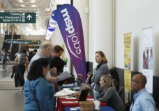 In this Tuesday, July 17, 2018, photograph, applicants chat with potential employers during a jobs fair at Minneapolis International Airport in Minneapolis. On Tuesday, Aug. 6, the Labor Department reports on job openings and labor turnover for June. (AP Photo/David Zalubowski)