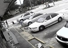 "FILE - In this July 19, 2018 file frame from surveillance video released by the Pinellas County Sheriff's Office, Markeis McGlockton, far left, is shot by Michael Drejka during an altercation in the parking lot of a convenience store in Clearwater, Fla. Prosecutors charged a white man, Michael Drejka, with manslaughter Monday Aug. 13, 2018 in the death of an unarmed black man whose videotaped shooting in a store parking lot has revived debate over Florida's ""stand your ground"" law. (Pinellas County Sheriff's Office via AP, File)"