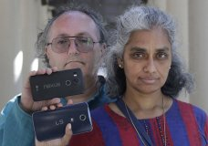 "In this July 25, 2018 photo, Kalyanaraman Shankari, right, and her husband Thomas Raffill hold their phones while posing for photos in Mountain View, Calif. An Associated Press investigation shows that using Google services on Android devices and iPhones allows the search giant to record your whereabouts as you go about your day. Shankari, a graduate researcher at UC Berkeley who connects commuting patterns with urban planners, noticed that her Android phone prompted her to rate a shopping trip to Kohl's. That happened even though she had turned off Google's ""location history"" setting, which according to the company should prevent it from remembering where a user has been. (AP Photo/Jeff Chiu)"