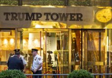 """In this July 27, 2018 photo, police investigate the report of a """"suspicious item"""" inside Trump Tower on Fifth Avenue, in New York. AP explains why the Trump Tower meeting matters in the Mueller probe. (AP Photo/Craig Ruttle)"""