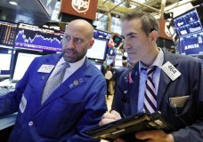 FILE- In this Sept. 14, 2018, file photo specialist Meric Greenbaum, left, and trader Gregory Rowe work on the floor of the New York Stock Exchange. The U.S. stock market opens at 9:30 a.m. EDT on Friday, Sept. 21. (AP Photo/Richard Drew, File)