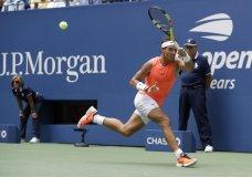 Rafael Nadal, of Spain, returns a shot to Nikoloz Basilashvili, of Georgia, during the fourth round of the U.S. Open tennis tournament, Sunday, Sept. 2, 2018, in New York. (AP Photo/Carolyn Kaster)