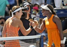 Anastasija Sevastova, left, of Latvia, shakes hands with Sloane Stephens after Sevastova defeated Stephens during the quarterfinals of the U.S. Open tennis tournament, Tuesday, Sept. 4, 2018, in New York. (AP Photo/Carolyn Kaster)