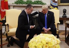 President Donald Trump prays with American pastor Andrew Brunson in the Oval Office of the White House, Saturday October 13, 2018, in Washington. Brunson returned to the U.S. around midday after he was freed Friday, from nearly two years of detention in Turkey. (AP Photo/Jacquelyn Martin)