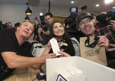 Canopy Growth CEO Bruce Linton, left to right, poses with the receipt for the first legal cannabis for recreation use sold in Canada to Nikki Rose and Ian Power at the Tweed shop on Water Street in St. John's N.L. at 12:01 am NDT on Wednesday Oct. 17, 2018. (Paul Daly/The Canadian Press via AP)