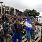 Caravan Migrants Break Guatemala Border Fence, Rush Mexico