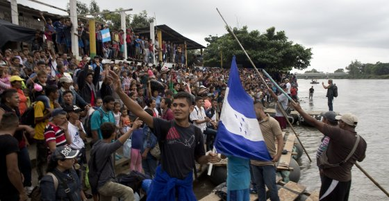Hundreds of Honduran migrants stand at the shore of the Suchiate river on the border between Guatemala and Mexico, in Tecun Uman, Guatemala, Thursday, Oct. 18, 2018. Mexico's foreign ministry says government officials at its southern border with Guatemala have started assisting the early arrivals from a caravan of some 3,000 Honduran migrants that has drawn sharp criticism from U.S. President Donald Trump. (AP Photo