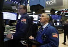 Specialist Gregg Maloney, left, and trader Timothy Nick work on the floor of the New York Stock Exchange, Wednesday, Oct. 24, 2018. Stocks are off to a mixed start on Wall Street as gains for Boeing and other industrial companies are offset by losses elsewhere in the market. (AP Photo/Richard Drew)