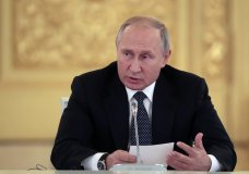 Russian President Vladimir Putin speaks during a joint with Italian Prime Minister Giuseppe Conte meeting with Italian businessmen including attending by video link the opening of a high-voltage electric engine plant of the Russian Electric Engines company in the Russian city of Chelyabinsk, in the Kremlin in Moscow, Russia, Wednesday, Oct. 24, 2018. Italian Prime Minister Giuseppe Conte is holding talks with Russian officials on his first trip to Moscow. (Sergei Chirikov/Pool Photo via AP)