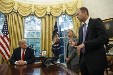 President Donald Trump meets with Homeland Security Secretary Kirstjen Nielsen and FEMA Administrator Brock Long in the Oval Office of the White House in Washington, Wednesday, Oct. 10, 2018. (AP Photo/Pablo Martinez Monsivais)