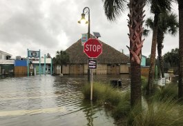 The St. Marks River overflows into the city of St. Marks, Fla., ahead of Hurricane Michael, Wednesday, Oct. 10, 2018. The hurricane center says Michael will be the first Category 4 hurricane to make landfall on the Florida Panhandle. (AP Photo/Brendan Farrington