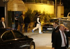 """Turkish police forensic officer exits the Saudi Arabia's Consulate in Istanbul, Monday, Oct. 15, 2018. Turkey and Saudi Arabia are conducting a joint """"inspection"""" on Monday of the consulate, where Saudi journalist Jamal Khashoggi went missing nearly two weeks ago, Turkish authorities said.v(AP Photo/Emrah Gurel)"""