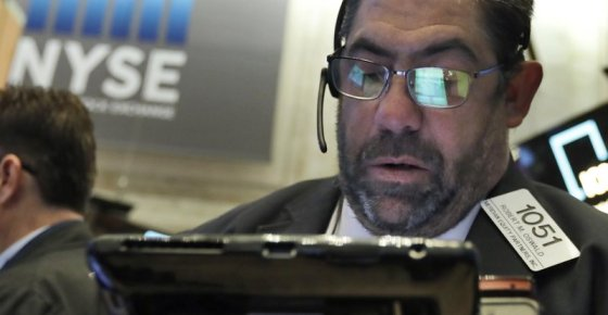 The handheld device of trader Robert Oswald is reflected in his glasses as he works on the floor of the New York Stock Exchange, Friday, Oct. 19, 2018. Strong earnings are sending U.S. stocks higher Friday at the end of a choppy week of trading. (AP Photo/Richard Drew)