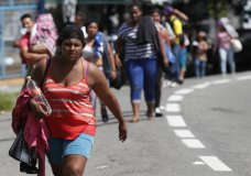 Central American migrants making their way to the U.S. arrive by foot to Tapachula, Mexico, Sunday, Oct. 21, 2018. (AP Photo/Moises Castillo)