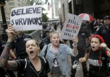 Protesters rally in front of Trump Tower in New York, Thursday, Oct. 4, 2018. Hundreds of people rallied in front of Trump Tower then walked to Times Square to protest Supreme Court nominee Brett Kavanaugh. (AP Photo/Seth Wenig)