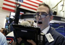 Trader Gregory Rowe works on the floor of the New York Stock Exchange, Tuesday, Oct. 23, 2018. Stocks are opening sharply lower on Wall Street following big drops in Asia and Europe. (AP Photo/Richard Drew)