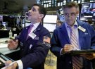 FILE- In this Oct. 11, 2018, file photo trader Peter Mazza, left, works with trader Daniel Trimble on the floor of the New York Stock Exchange. The U.S. stock market opens at 9:30 a.m. EDT on Thursday, Oct. 18. (AP Photo/Richard Drew, File)