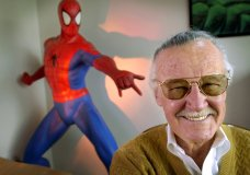 "FILE - In this April 16, 2002, file photo, Stan Lee, 79, creator of comic-book franchises such as ""Spider-Man,"" ""The Incredible Hulk"" and ""X-Men,"" smiles during a photo session in his office in Santa Monica, Calif. Comic book genius Lee, the architect of the contemporary comic book, has died. He was 95. (AP Photo/Reed Saxon, File)"