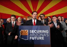 Arizona Gov. Doug Ducey, R, speaks to supporters, Tuesday, Nov. 6, 2018, at an election night party in Scottsdale, Ariz. Incumbent Ducey defeated democratic challenger David Garcia for his second term. (AP Photo/Matt York)