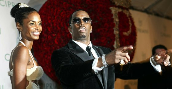 "File-This Nov. 4, 2004, file photo shows Sean ""P. Diddy"" Combs directing photographers as they sing ""Happy Birthday,"" to him as his date Kim Porter, left, listens, after Combs arrived for his 35th birthday celebration at Cipriani on Wall Street in New York. Porter, Diddy's former longtime girlfriend and the mother of three of his children, has died. A representative for Combs confirmed the death of the 47-year-old on Thursday, Nov. 15, 2018. No further details were immediately available. (AP Photo/Kathy Willens, File)"