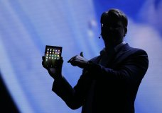 Justin Denison, SVP of Mobile Product Development, shows off the Infinity Flex Display of a folding smartphone during the keynote address of the Samsung Developer Conference Wednesday, Nov. 7, 2018, in San Francisco. (AP Photo/Eric Risberg)