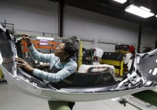 Final inspector Mary Skinner inspects the rear end of a General Motors Chevrolet Cruze at Jamestown Industries, Wednesday, Nov. 28, 2018, in Youngstown, Ohio. Jamestown Industries supplies parts for the Chevy Cruze. GM said Monday that Lordstown will stop making the Chevy Cruze by March, at a cost of 1,400 union jobs on top of the 2,700 lost there since President Donald Trump took office. (AP Photo/Tony Dejak)